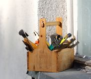 Toolbox and tools. Wooden toolbox and hand tools Royalty Free Stock Photos