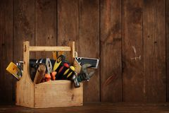 Retro wooden toolbox. Wooden toolbox with tools over wood Royalty Free Stock Photos