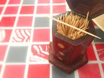 Toothpick in wooden box royalty free stock photography
