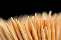 Wooden Toothpicks Close-Up on Black Background Royalty Free Stock Photos