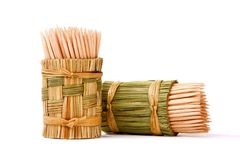 Wooden toothpicks in an original wattled basket Stock Images