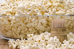 Wooden toothpicks and popcorn Royalty Free Stock Photos