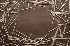 Wooden toothpicks on the table background Stock Images