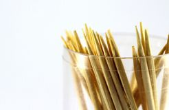 Wooden toothpicks in a transparent container, close-up. Royalty Free Stock Image