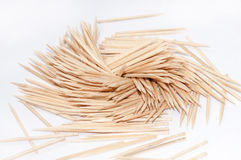 Wooden toothpicks on the white background Royalty Free Stock Photos