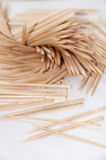 Wooden toothpicks on the white background Royalty Free Stock Images