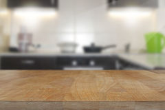 Wooden top table with blurred kitchen interior background Royalty Free Stock Photo