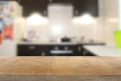 Wooden top table with kitchen interior background