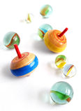Wooden tops and marbles Royalty Free Stock Photography