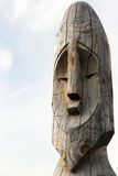 Wooden totem pole. Wooden totem idol pole with a sky as a background Royalty Free Stock Photos