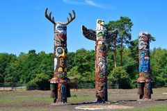 Wooden totem poles stock photo