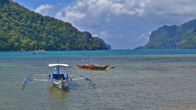 Wooden tourist boat in the beautiful tropical beach of El Nido, Palawan. Empty wooden tourist boat in the beautiful tropical beach landscape at summer stock video footage