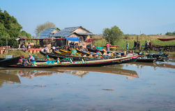 Wooden tourist boats near traditional open market on Inle lake, Royalty Free Stock Photo