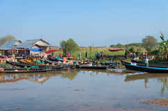 Wooden tourist boats near traditional open market on Inle lake, Stock Photography