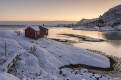 Wooden tourist cabin, rorbu, on nordic winter coast in Lofoten w. Wooden tourist cabin, rorbu, on nordic winter coast near Tind and Sorvagen, Lofoten, Norway Royalty Free Stock Images