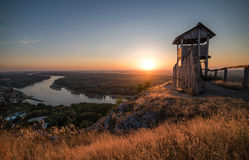 Wooden Tourist Observation Tower above a Little City with River Stock Photo