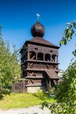 Wooden tower of belfry in Hronsek, Slovakia. Hronsek, Slovakia - AUGUST 06, 2015: Hronsek. Old fully wooden one of the five preserved artucular churches in Stock Photography