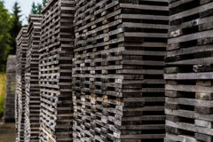 Pile of decayed lumber stacked on top each other. Wooden tower of stacked lumber Royalty Free Stock Photo