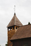 Wooden tower with a weather vane Royalty Free Stock Photo