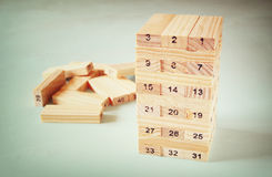 Wooden tower of wooden blocks with numbers on it. planing and strategy concept Stock Photography