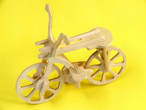 Wooden toy. Decorative item - handicraft folk wooden bicycle Royalty Free Stock Photography