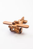 Wooden toy airplane isolated on white Stock Photo