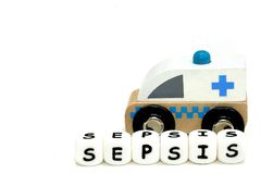 wooden toy ambulance and a word sepsis stock photos