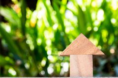 Free Wooden Toy As Dream House Concept With Blurred Green Background Royalty Free Stock Photo - 100726185