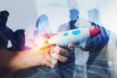 Businessman launches his startup company. Hand holding a wooden rocket. double exposure with light effects stock images