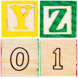 Wooden toy blocks with letters and numbers Royalty Free Stock Photos