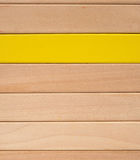 Wooden toy blocks with one piece in yellow others in natural color Stock Photos