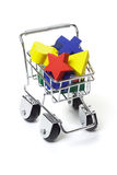 Wooden toy blocks in shopping cart Stock Images