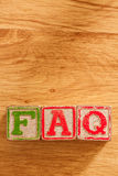 Wooden Toy Blocks Spell FAQ Stock Photography