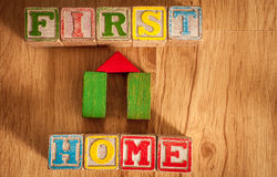 Wooden Toy Blocks Spell First Home Stock Images