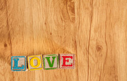 Wooden Toy Blocks Spell Love Royalty Free Stock Photos