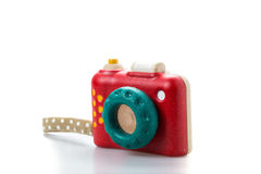Wooden toy camera on white background.  Stock Photo