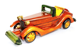 Wooden toy car. Old wooden toy car. Lacquered and shiny Stock Photography