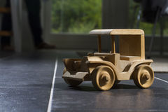 Wooden toy car. Wooden tooy car on tiled floor Stock Photos