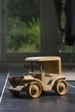 Wooden toy car. Wooden tooy car on tiled floor Royalty Free Stock Photo