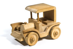 Wooden toy car. Wooden tooy car on white background Royalty Free Stock Images