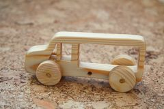 Wooden toy car bus. Handmade with a pronounced wood structure Royalty Free Stock Photos
