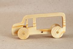Wooden toy car bus. Handmade with a pronounced wood structure Royalty Free Stock Photography