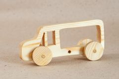 Wooden toy car bus. Handmade with a pronounced wood structure Stock Image