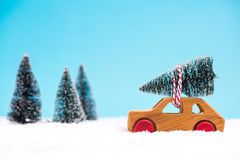 Wooden toy car carrying Christmas tree stock photos