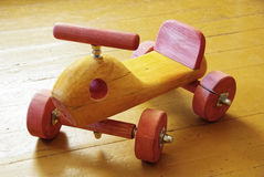 Wooden toy car. Childish wooden hand made big toy car Royalty Free Stock Photos