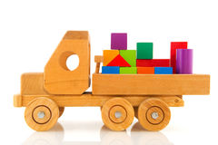 Wooden toy car with colorful blocks Stock Photo