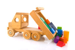Wooden toy car with colorful blocks. Old wooden toy car truck with colorful blocks Royalty Free Stock Images