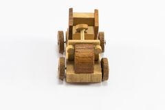 Wooden toy car miniature on white background Stock Photography
