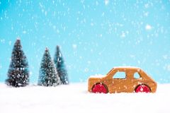 Wooden toy car in snowy wonder land forest royalty free stock images