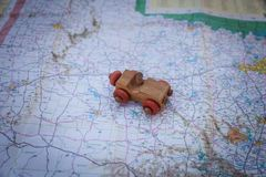 Wooden toy car on a state map of Texas. Old wooden toy car on a State of Texas road map Stock Photo